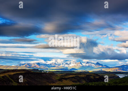 Typical Iceland landscape with mountains and cloudy sky. Summer time - Stock Photo