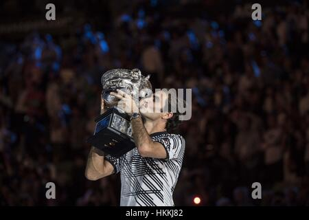 Melbourne, Australia. 29th Jan, 2017. Roger Federer of Switzerland kisses his trophy during the awarding ceremony - Stock Photo