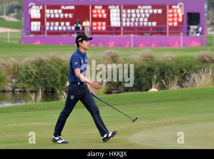 Doha, Qatar. 28th Jan, 2017. Wang Jeunghun of South Korea walks towards the 18th green during the third day match - Stock Photo