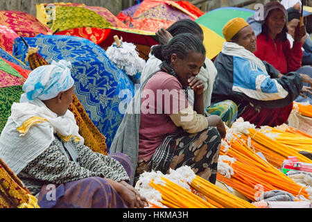 Selling religious items at Meskel Festival at Holy Trinity Cathedral, Addis Ababa, Ethiopia - Stock Photo