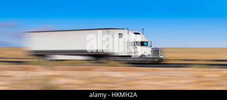 white truck on the move in the desert - Stock Photo