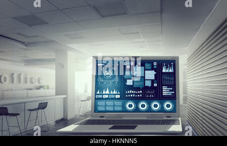 Modern office with big laptop and infographs on screen. Mixed media - Stock Photo