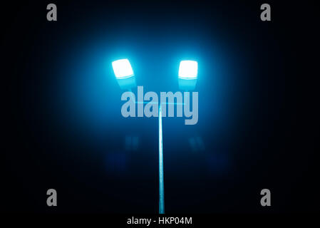 Illuminated basketball court against sky in city stock photo outdoor sport court or stadium lights against dark night sky stock photo aloadofball Gallery