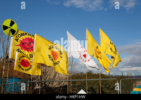 Flags at Anti nuclear protest at Hinkley Point north Somerset . Protesters have occupied a  farmhouse as EDF clear - Stock Photo