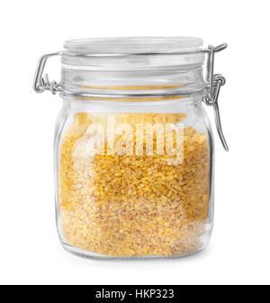 bulgur in glass jar isolated on white - Stock Photo