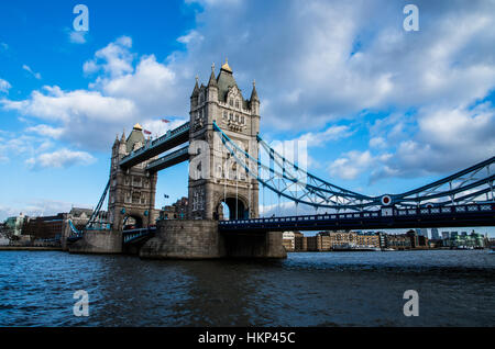 The iconic Tower Bridge with his great profile against the blu sunny sky in winter. - Stock Photo