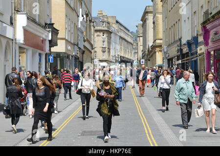 Bath, UK - May 13, 2016: People walk on a city centre street. The Somerset city is a popular for its shopping and - Stock Photo