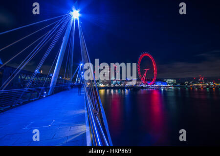 View of the London eye from the golden Jubilee bridge. - Stock Photo