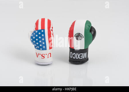 America-Mexico stand-off (Donald Trump) represented by USA and Mexican emblem boxing gloves. NAFTA breakdown concept. - Stock Photo