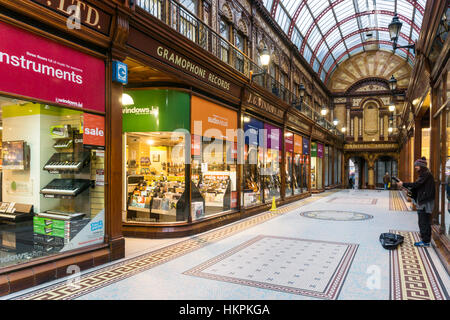 A busker in the Central Arcade, Newcastle.  The arcade was built in 1906 & designed by the Newcastle firm of Oswald - Stock Photo