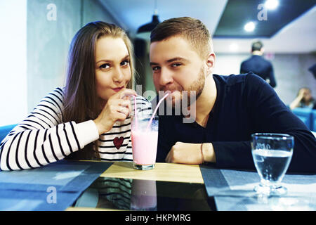 Two people in cafe enjoying the time spending with each other. Toned. Selective focus. - Stock Photo