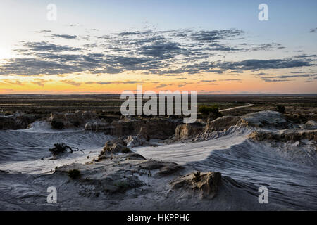 Sunset over the spectacular eroded rock formations of the Lunette, Mungo National Park, New South Wales, Australia - Stock Photo