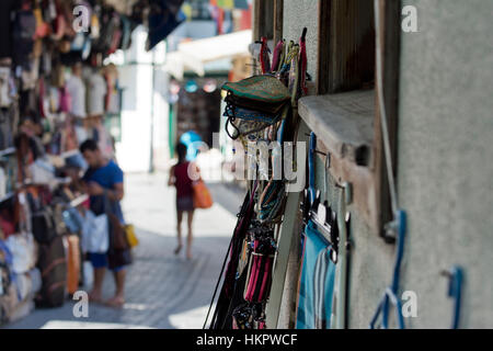 Typical cobbled stone back street and traditional Turkish shops in Kaleici in Antalya Turkey - Stock Photo