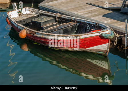 Small red Fishing Boat, named 'Adventure' in the Harbour of Scarborough on the North Sea coast of North Yorkshire, - Stock Photo