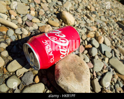 Classic coca cola drinks can litter Uk - Stock Photo