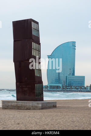 Modern art sculpture called L'Estel Ferit by Rebecca Horn on the beach of Barceloneta, with W hotel, Barcelona, - Stock Photo