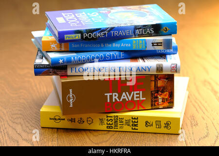Travel Guide Books on a table top - Stock Photo