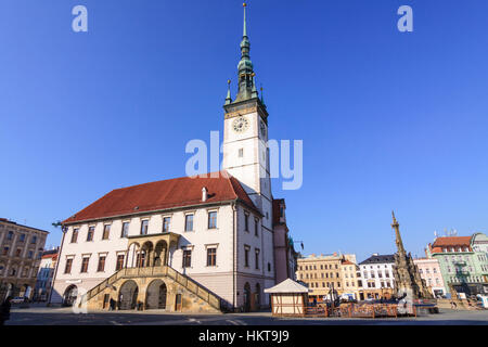 Town Hall and Holy Trinity Column at Upper Square (Horni nam) in Olomouc, Moravia, Czech Republic, Central Europe - Stock Photo