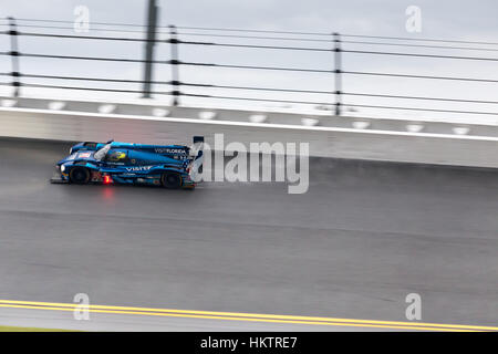 Daytona Beach, USA. 29th January, 2017. Drivers battle overnight rain and wet track conditions at the Daytona International - Stock Photo