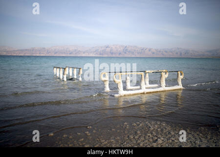 Salt deposits on railings in the Dead Sea near En Gedi in Israel, 22 January 2017. Sink holes are a growing problem in the Dead Sea, threatening both tourism and agriculture. The holes are due to sinking water levels which cause the sea to shrink by one meter each year.