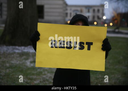 Bloomington, USA. 29 Jan, 2017. Protesters hold signs during the 'No Ban! No Wall!' rally at City Hall. The rally - Stock Photo