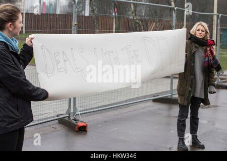 Cardiff, Wales, UK, January 30th 2017. Protesters hold a message outside Cardiff City Hall, where Prime Minister - Stock Photo