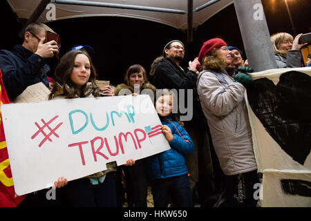 PROTESTING AGAINST DONALD TRUMP: Aberystwyth, Wales, UK. 30th Jan, 2017. Around 300 people of all ages and from - Stock Photo