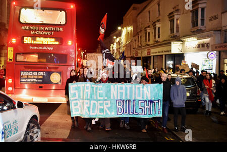 Brighton, UK. 30th Jan, 2017. Thousands of people march through Brighton as they take part in an Anti-Trump Protest - Stock Photo