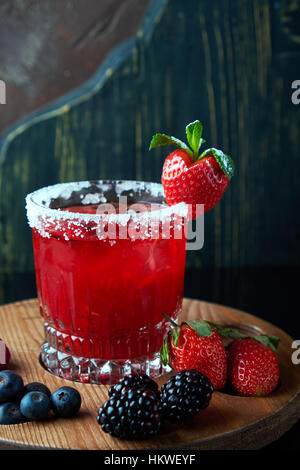 Alcoholic cocktail with berries