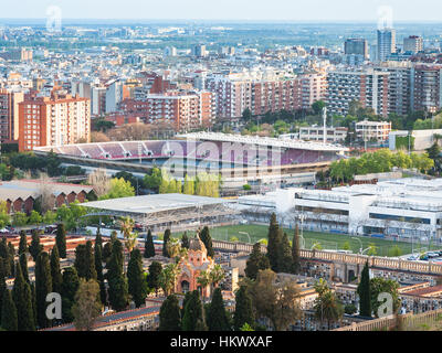Barcelona cityscape with Camp Nou stadium and cemetery in evening - Stock Photo
