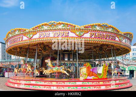 Children's carousel on beach promenade, Brighton, East Sussex, England, United Kingdom