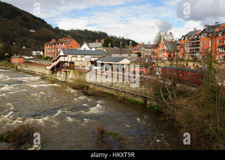 Llangollen Town Centre with the River Dee and the old heritage railway station - Stock Photo