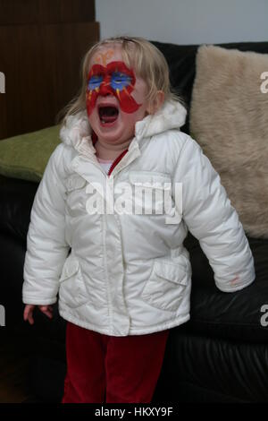 Little girl kid child, Screaming unhappy toddler child crying having a tantrum - Stock Photo