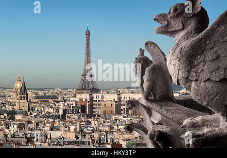 Eiffel Tower and Chimeras looking on Paris, France - Stock Photo