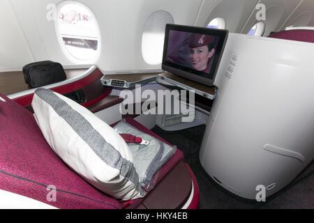 PARIS - JUN 18, 2015: First Class seat in a Qatar Airways Airbus A350. Qatar Airways is the first user of the A350 - Stock Photo