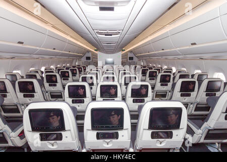 PARIS - JUN 18, 2015: Cabin view of a Qatar Airways Airbus A350. Qatar Airways is the first user of the A350 with - Stock Photo
