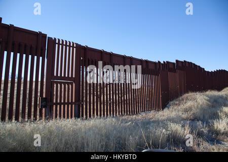 Border fence with gate near Nogales Arizona - Stock Photo