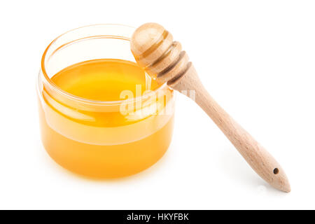 pot with honey and drizzler isolation  on a white background - Stock Photo