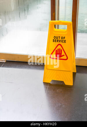 Bright yellow caution sign of Out of service - Stock Photo