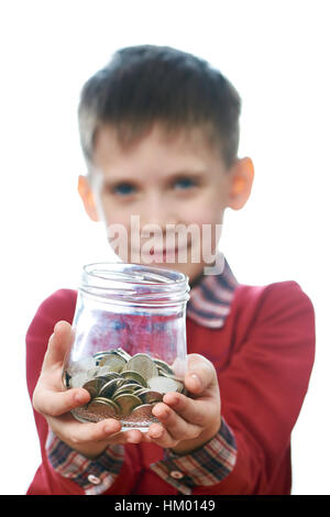 Beautiful little boy with glass jar of coins in his hands isolated white - Stock Photo