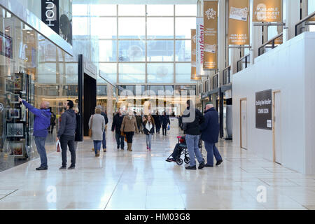 People shopping at the Intu Milton Keynes shopping Centre at the Point in Milton Keynes, England