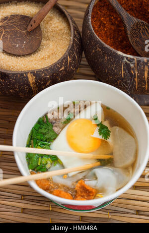 Noodle Soup with Egg and spices, Close Up View - Stock Photo