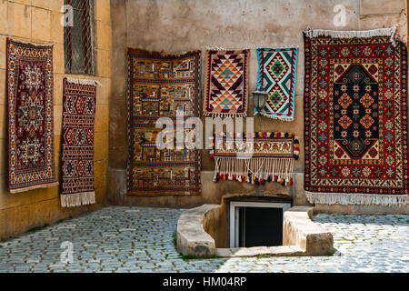 Sale of old carpet in eastern city - Stock Photo