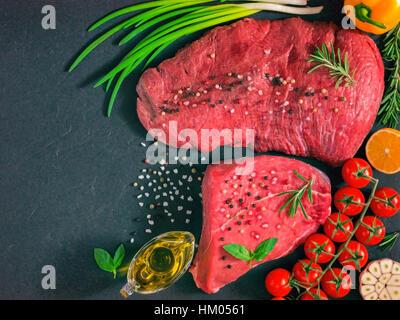 raw meat on dark background - Stock Photo