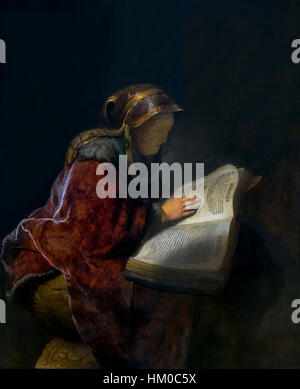 Old Woman Reading, probably the Prophetess Hannah, by Rembrandt, 1631, oil on panel, Rijksmuseum, Amsterdam, Netherlands, - Stock Photo