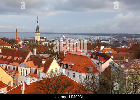 View from Tallinn Toompea hill to downtown with St. Olafs church, towers and red roofs of the historical city center - Stock Photo