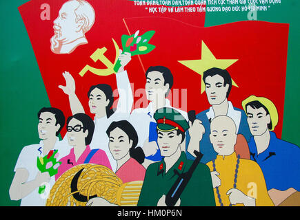Communist wallpainting depicting revolutionaries in front of the Vietnamese flag at the Independence Palace in Ho - Stock Photo