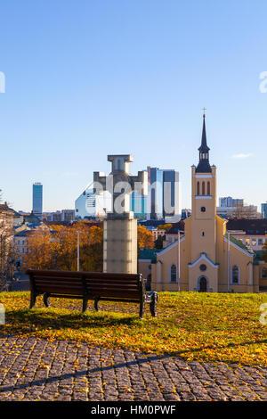 TALLINN, ESTONIA - 24 OKT 2015. Sunny summer view of Freedom Square, Estonian cross and St. John Church - Stock Photo
