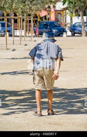 Man playing boules petanque provence southern france france stock photo - Regle de la petanque provencale ...