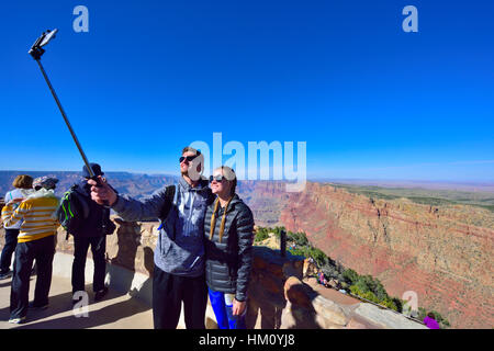 Couple taking selfy photographs, Grand Canyon National Park South Rim at Desert View Watchtower visitors viewpoint - Stock Photo